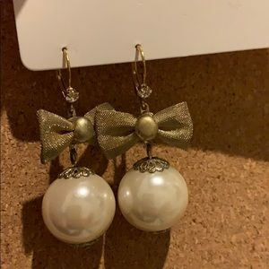 Large pearl and gold bow dangle earrings